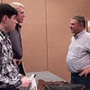 Chadron State College students Dusty Runner of Cambridge, Nebraska, left, and Will Krause of Canyon Lake,Texas, center, speak with Tony Malmberg, left, following his presentation about holistic range management Monday, November 9, 2015. (Tena L. Cook/Chadron State College)