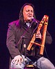 Grammy winning Native American musician Bill Birdsong Miller explains the significance of the flute in Memorial Hall Thursday, Nov. 12, 2015. (Tena L. Cook/Chadron State College)