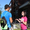 Incoming student Bryce Hargens of Bayard, Nebraska, left, learns more about New Student Orientation 2015 from NSO leader Andrea du Fresne of Colorado Springs, Colorado, right. (Photo by Tena L. Cook/CSC)