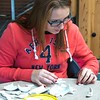 Carson Hadden of Alliance, Nebraska, pieces together a broken pottery item during Chadron State College's Art Day Monday, Nov. 9, 2015. (Tena L. Cook/Chadron State College)