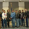 During the Chadron State College  Veterans Day program Nov. 11, 2015, members of the Dawes County Veterans of Foreign Wars Gray Eagle Post 1375 announced a $21,000 additional gift to an endowed scholarship they established with the Chadron State Foundation. Foundation development officer Leslie Bargen poses with the post members. (Tena L. Cook/Chadron State College)