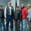 Chadron American Legion Riders announced the first recipient of the Cory Mracek Memorial scholarship, Brandon Girard of Alliance, Nebraska, in red, during a Veterans Day program at Chadron State College Wednesday, Nov. 11, 2015. From left, Don Clausen, Chuck James, Ron Cashon, Kathy Stokey and Barb Reed. (Tena L. Cook/Chadron State College)