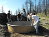 Members of the Chadron State College Rocky Mountain Elk Foundation club work on a water tank for wildlife on U.S. Forest Service land south of Chadron. (Photo courtesy Tylee Evans)