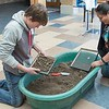 Karsen Hunter of Bayard, Nebraska, left, and Oshie Shizzle of Oelrichs, South Dakota, participate in a replicated archaeology dig at the Mari Sandoz High Plains Heritage Center during Chadron State College's Art Day Monday, Nov. 9, 2015. (Tena L. Cook/Chadron State College)