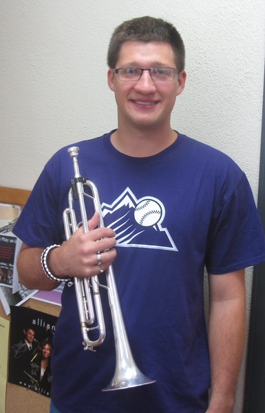 Chadron State College music major Curtis Stevens poses with his trumpet. He spent the summer in Europe as a band camp counselor. (Courtesy photo)