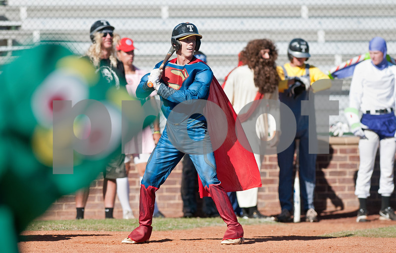 dressed as gumby watches the outfield from the dugout during a special halloween game thursday oct 30 at mike carter field in tyler texas