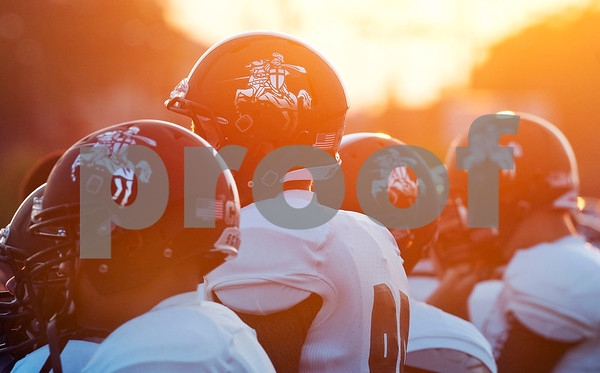 The sun sets as Bishop T.K. Gorman football players stand on the sideline during their school's football game against Eustace at All Saints Episcopal School Friday night Aug. 28, 2015. The game was part of the Azalea Orthopedics and Texas Spine and Joint Hospital Football Classic.  (Sarah A. Miller/Tyler Morning Telegraph)