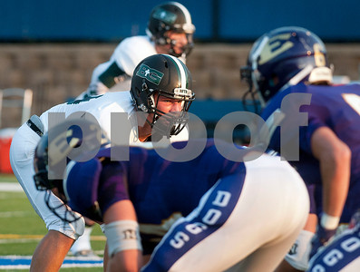 Bishop T.K. Gorman football player Tyler Bate gets in his stance for the start of a play during their game against Eustace at All Saints Episcopal School Friday night Aug. 28, 2015. The game was part of the Azalea Orthopedics and Texas Spine and Joint Hospital Football Classic.  (Sarah A. Miller/Tyler Morning Telegraph)
