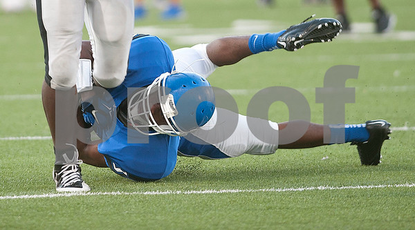 John Tyler's Ricky Hill (36) tackles Mount Pleasant's JK Lee (2) during a scrimmage Friday night at John Tyler High School.  (Sarah A. Miller/Tyler Morning Telegraph)