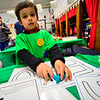 KRISTOPHER RADDER — BRATTLEBORO REFORMER<br /> Adrian Abbondanzio, 4, tries to make letters during the annualNight at the Museum  at  St. Michael's Roman Catholic Church on Thursday, April 11, 2019.