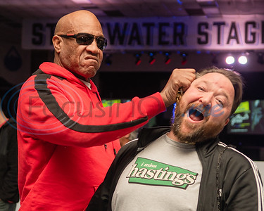 "Tom Lister Jr., known for his role as Debo in the hit nineties film ""Friday,"" (left) acts out his iconic choking scene with Tyler native Clay Riggs during Night of Nostalgia Saturday, March 7, 2020, at Harvey Hall Convention Center in Tyler."
