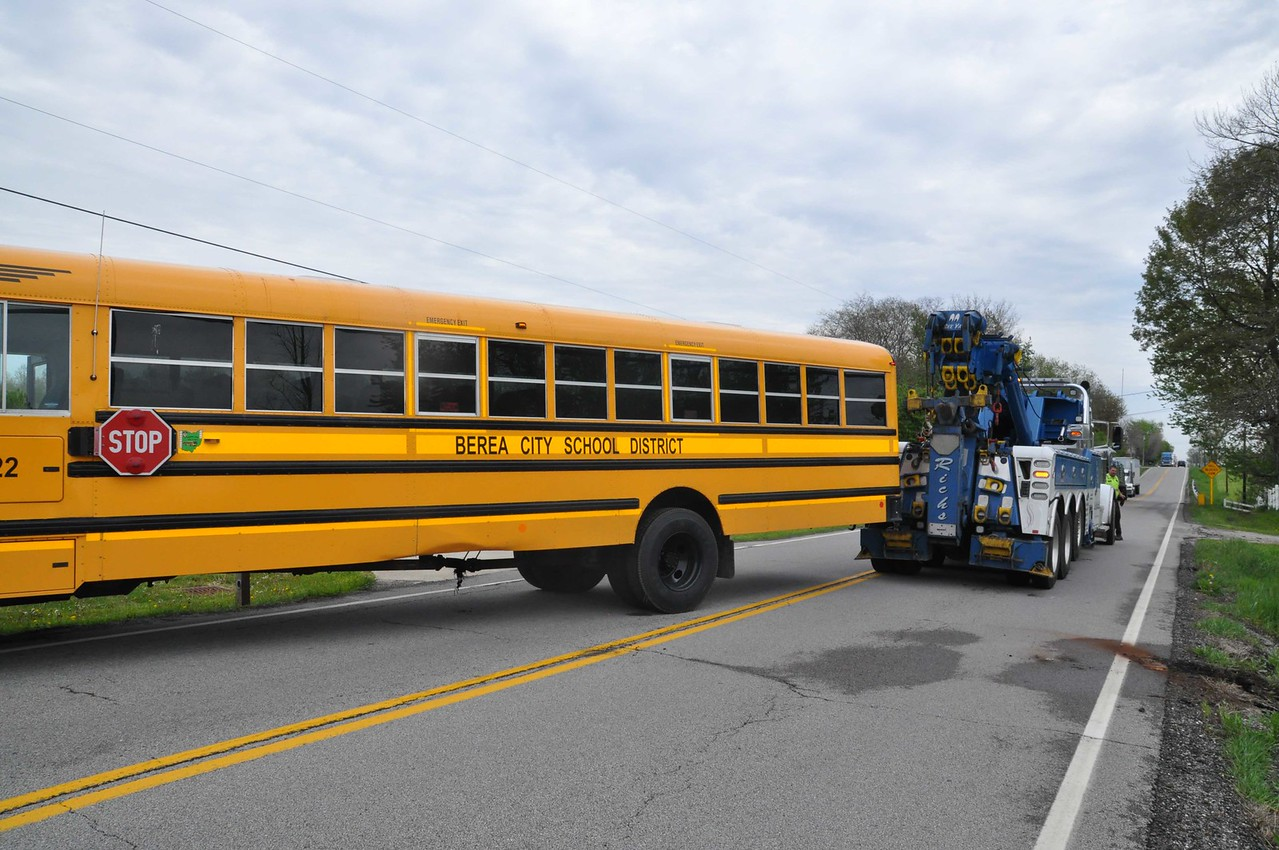 ASHLEY FOX / GAZETTE A school bus carrying around 40 students backed into a ditch Tuesday morning on Greenwich Rd. in Seville. No one was hurt.