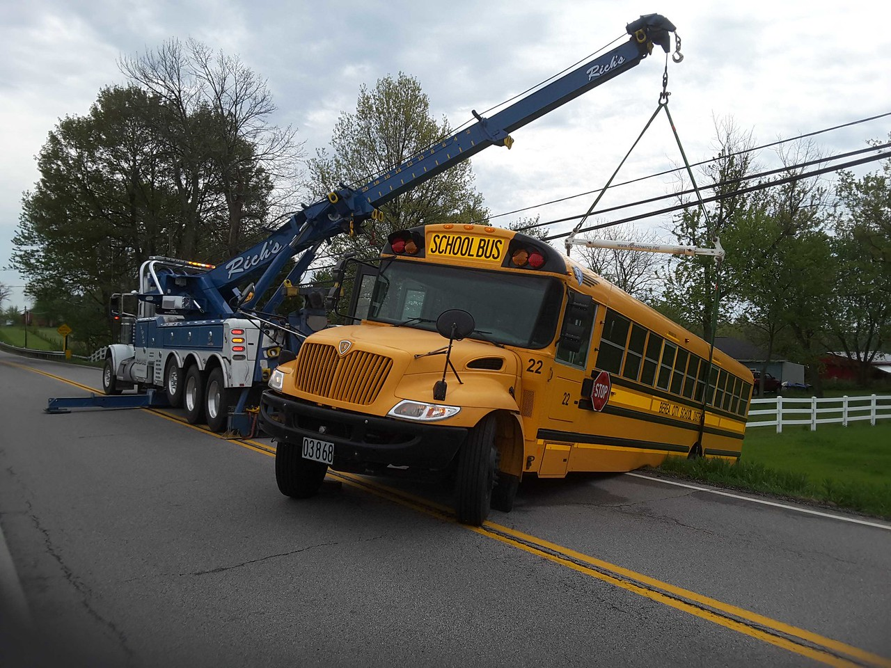 PHOTO PROVIDED/ COURTESY OF BOB SCHMIDT A school bus driver misjudged distance when backing up on Greenwich Rd. in Seville Tuesday morning.