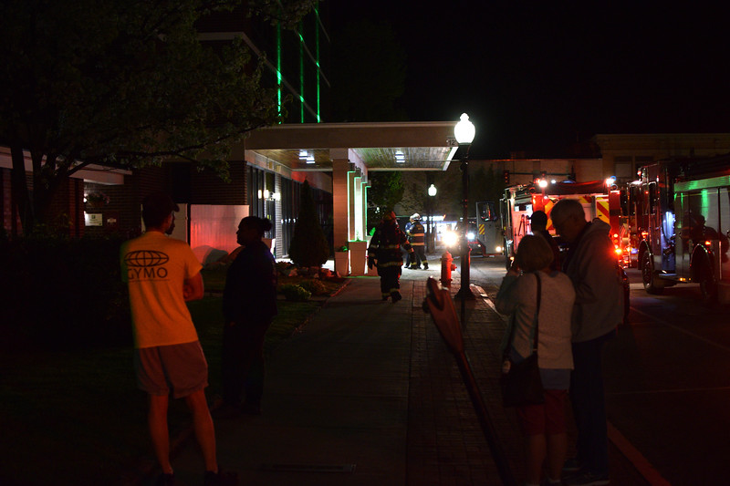 ADAM SHANKS — THE BERKSHIRE EAGLE<br /> Guests at the Holiday Inn in North Adams wait outside as firefighters work to clear a fire in the hotel's basement early Tuesday morning.
