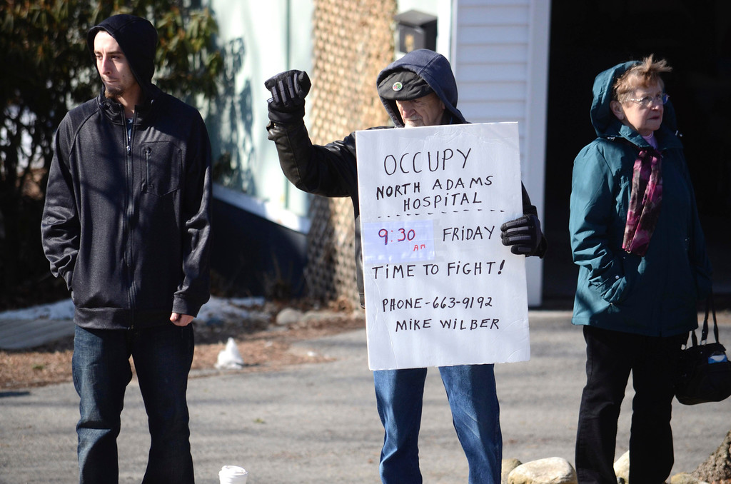 . Mike Wilbur holds an sign outside of the Hospital organizing the protests. Thursday, March 27, 2014. Ben Garver / Berkshire Eagle Staff / photos.berkshireeagle.com
