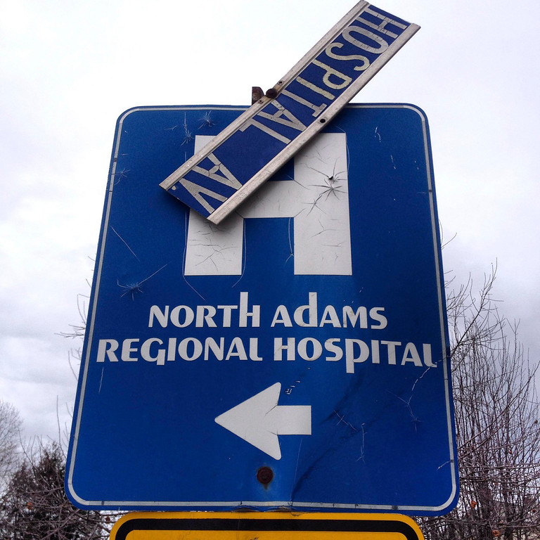 . The street sign on Hospital Ave. in North Adams hangs broken.  Wednesday March 26, 2014.  Ben Garver / Berkshire Eagle Staff / photos.berkshireeagle.com