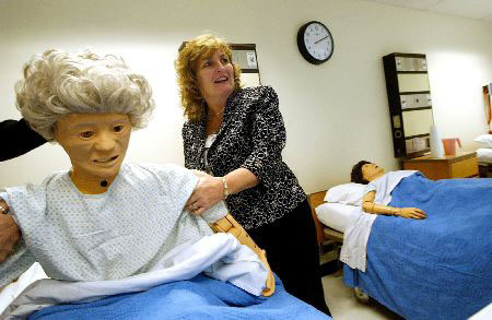 Description of . Billie Allard, Vice President of Patient Care at NARH checks out one of the new life form nursing skills mannequins in the nursing simulation lab during the unveiling of the new LPN training space at NARH. Thu Jan 25 2007
