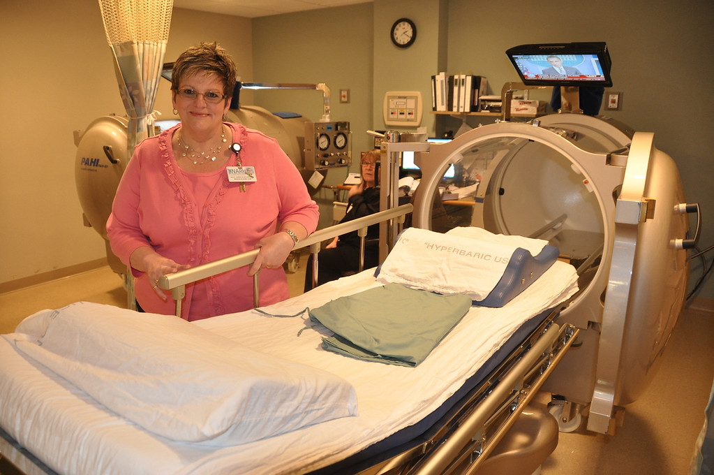 . Gillian Jones/North Adams Transcript File Kelly Morse stands with one of the two hyperbaric chambers that North Adams Regional Hospital has in their Wound Center.