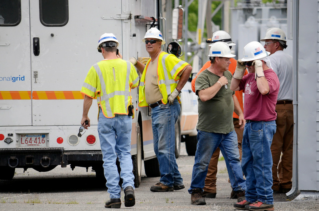 . A crew from National Grid prepares to work at the Adams substation after a blackout hit North Berkshire County. Tuesday July 8, 2014.  Ben Garver / Berkshire Eagle Staff / photos.berkshireeagle.com