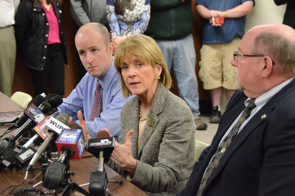 . Attorney General Martha Coakley speaks to the media in North Adams City Hall after meeting with State Senator Benjamin Downing, left, Mayor Richard Alcombright, right, and State Representative Gailanne Cariddi, not shown, on Tuesday, April, 1, 2014. Gillian Jones / Berkshire Eagle Staff / photos.berkshireeagle.com