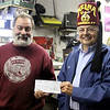 """Mike Roberts, owner of Custom City cycles has raised and donated over $ 500,000 dollars for the Shriners hospital for children. The money has been raised since 1982 and he remarks it could not have been done without the support of all the riders who take part in the annual """"Fall Run"""" November 7th 2013 Holly Pelczynski/Berkshire Eagle Staff"""