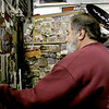 """Mike Roberts, owner of Custom City cycles looks through old photographs of """"Fall Runs"""" of the past. Roberts has raised and donated over $ 500,000 dollars for the Shriners hospital for children. The money has been raised since 1982 and he remarks it could not have been done without the support of all the riders who take part in the annual """"Fall Run"""" November 7th 2013 Holly Pelczynski/Berkshire Eagle Staff"""