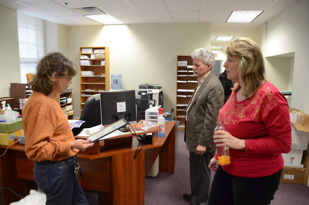 . Ecu-Health settles into their new location at 26 Union Street in North Adams on Tuesday, April, 15, 2014. From left are Pat Flaherty, Chip Joffe-Halpern, and Melissa Dobbert. Gillian Jones / Berkshire Eagle Staff / photos.berkshireeagle.com