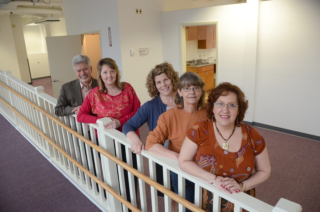 . Ecu-Health settles into their new location at 26 Union Street in North Adams on Tuesday, April, 15, 2014. From left are Chip Joffe-Halpern, Melissa Dobbert, Sue Budz, Pat Flaherty and Karen Baumbach. Gillian Jones / Berkshire Eagle Staff / photos.berkshireeagle.com