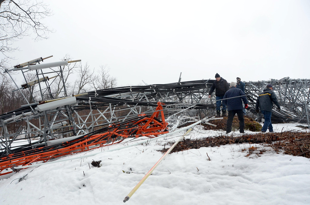 . High winds overnight have toppled the communications tower at the Western Summit in North Adams impacting cell service to North Adams and some surrounding communities. Workers with Pittsfield Communications access the damage. Gillian Jones / Berkshire Eagle Staff / photos.berkshireeagle.com