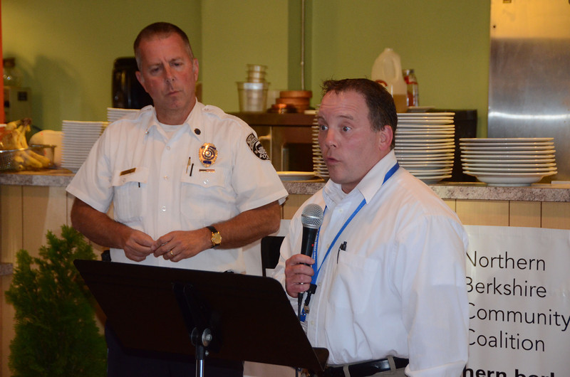 North Adams Police Director Michael Cozzaglio, left, listens while State Police Lt. Brian Foley, of the Berkshire County Drug Task Force, speaks during a kick-off dinner on Monday, Aug. 5, 2013, at MediTerra to launch the nb21 (not before 21) North Adams Strategy Team, which aims to prevent and reduce underage substance abuse and drinking.(Gillian Jones/North Adams Transcript)