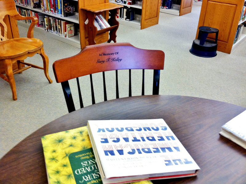 A donation of four hardwood chairs in honor of long-time educator George F. Kelley was recently made to the North Adams Public Library. (Jennifer Huberdeau/North Adams Transcript)