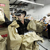 "Volunteer Don McLaughlin places bags of oranges into a storage bin on Tuesday, March 13, at the North Denver Cares Food Pantry at 6900 West 117th Avenue in Broomfield. For more photos and video of the food pantry go to  <a href=""http://www.dailycamera.com"">http://www.dailycamera.com</a><br /> Jeremy Papasso/ Camera"