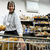 "Volunteer Carolynn Keefner places food into a shopping cart for a client on Tuesday, March 13, at the North Denver Cares Food Pantry at 6900 West 117th Avenue in Broomfield. For more photos and video of the food pantry go to  <a href=""http://www.dailycamera.com"">http://www.dailycamera.com</a><br /> Jeremy Papasso/ Camera"