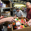 "Volunteers Randy Wickwire, left, Joseph Lautrup, and Steve Hayen place canned goods into a box for people in need on Tuesday, March 13, at the North Denver Cares Food Pantry at 6900 West 117th Avenue in Broomfield. For more photos and video of the food pantry go to  <a href=""http://www.dailycamera.com"">http://www.dailycamera.com</a><br /> Jeremy Papasso/ Camera"