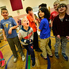 KRISTOPHER RADDER — BRATTLEBORO REFORMER<br /> Logan Moore, a fourth-grader at Dover Elementary School, cheers the teachers as they practice different circus arts skills on Tuesday, Dec. 4, 2018.