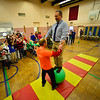 KRISTOPHER RADDER — BRATTLEBORO REFORMER<br /> Troy Wunderle, of Big Top Adventures, has Matthew Martyn, the principal of Dover Elementary School, balance on the big ball in front of a group of students on Tuesday, Dec. 4, 2018. The school will put on a show that is open to the community on Friday, at 1 p.m.