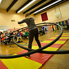 KRISTOPHER RADDER — BRATTLEBORO REFORMER<br /> Alicia DeWire, a staff member at Dover Elementary School, keeps two big hula hoops up while practicing in front of a group of students on Tuesday, Dec. 4, 2018. The school will put on a show that is open to the community on Friday, at 1 p.m.