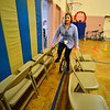 KRISTOPHER RADDER — BRATTLEBORO REFORMER<br /> Alison Sullivan, a staff member at Dover Elementary School, has been trying to learn how to ride the unicycle for nearly a year. Sullivan uses a row of two chairs to help keep her balance on Tuesday, Dec. 4, 2018.