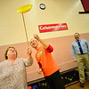 KRISTOPHER RADDER — BRATTLEBORO REFORMER<br /> Troy Wunderle, of Big Top Adventures,  helps Nancy Baker, a staff member of Dover Elementary School, as she twirls a disc on a stick on Tuesday, Dec. 4, 2018.