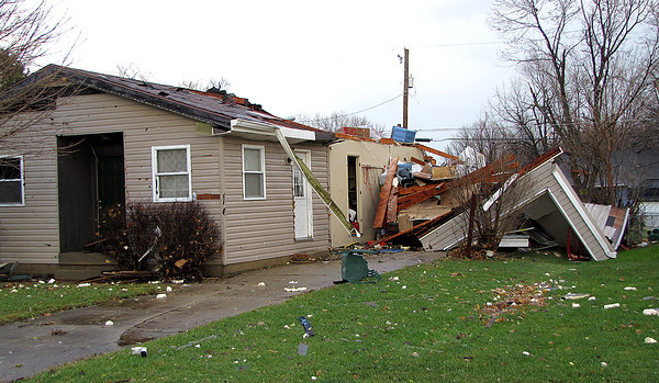 Reporter photo by Rod Rose<br /> A garage was leveled and the adjacent home on South Meridian Street heavily damaged by a tornado Sunday afternoon.