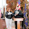 Reporter photo by Rod Rose<br /> After laying a wreath, Rachel Hawes of the Veterans of Foreign Wars Auxiliary in Lebanon reads a poem commemorating the memory of the nation's veterans, as George Cox holds a megaphone, during Monday's Veterans Day ceremony at the Boone County Veterans Memorial in Lebanon.