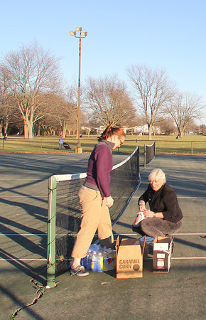 Saski Graddy and Natalie Woolery of Joe Kidwell State Farm in Lebanon, bring snacks and water to volunteers at Abner Longley Southside Park Monday afternoon.