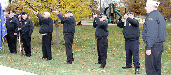 Reporter photo by Rod Rose<br /> The honor guard from the Lebanon post of the Veterans of Foreign Wars fires a salute during Monday's Veteran's Day ceremonies at Memorial Park.