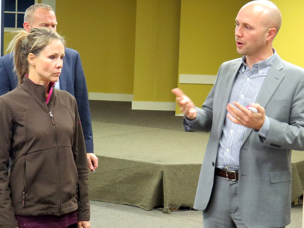 Melissa Brewer listens to Peter Lemmon, of TADI, Wednesday night, Nov. 13, during an open house for the downtown market study and parking analysis. Residents were able to offer their input on strengths, opportunities and challenges facing the downtown area.