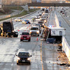 Reporter photo by Rod Rose<br /> The shattered remnants of a box trailer rest against the median after it, and the tractor trailer at left, were lifted from the Flying J Truck Stop parking lot and dropped onto southbound Interstate 65, just north of Indiana 39, when a tornado tore across the southern half of Lebanon late Sunday afternoon. Traffic was limited to one lane, and then closed for a lengthy period, as the wreckage was removed. Two people were taken to Witham Memorial Hospital with minor injuries as a result of the incident, an Indiana State Police trooper said.