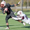 J.S.CARRAS - JCARRAS@DIGITALFIRSTMEDIA.COM   Union College defender Tyler Valenti (19) tackles Rensselaer Polytechnic Institute ball carrier Reggie Colas (1) during third quarter of college football action Saturday, November 15, 2014 at ECAV Stadium in Troy, N.Y..