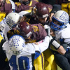 J.S.CARRAS - JCARRAS@DIGITALFIRSTMEDIA.COM  Fonda's backfield is swarmed by Hoosick Falls defenders during first quarter of Class C high school football Super Bowl action Friday, November 7, 2014 at Stillwater High School in Stillwater, N.Y..