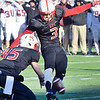 J.S.CARRAS - JCARRAS@DIGITALFIRSTMEDIA.COM   Rensselaer Polytechnic Institute's Casey McHugh (15) holds as kicker Andrew Franks (3) boots the ball through the uprights that seal a 31-28 victory over Union College Saturday, November 15, 2014 to capture the Dutchmen Shoes trophy at ECAV Stadium in Troy, N.Y..