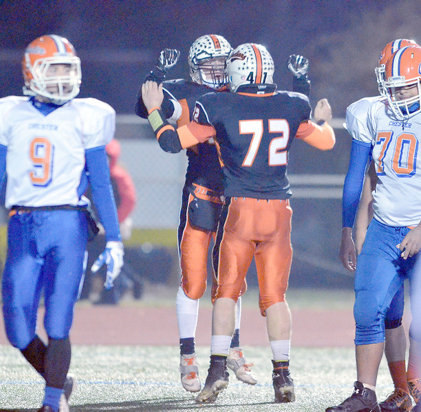 J.S.CARRAS - JCARRAS@DIGITALFIRSTMEDIA.COM Cambridge's Caleb Rowland celebrates his touchdown with Colton Dean (72) against Chester during second quarter of New York State Class D high school football semi-final action  Friday, November 21, 2014 at Dietz Stadium in Kingston, N.Y..