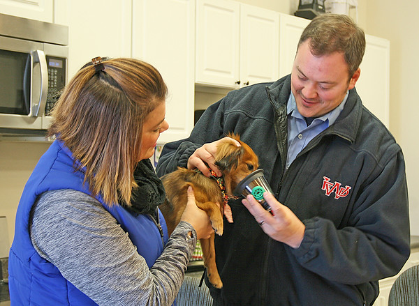 "BREATHING MASK FOR BOWSER<br /> Elizabeth Pearl | The Lebanon Reporter<br /> SAVING ANIMAL LIVES: Whitestown Fire Department Firefighter Marty Yohler practices using an animal oxygen mask on Scout, a male dachshund, with the help of Stacy Goins, community outreach specialist at Invisible Fence. Invisible Fence provided WFD with two free sets of breathing masks designed to help animals who have inhaled smoke. The masks come in three different sizes and can be used for large dogs and cats, and have even been used to save hamsters and guinea pigs, Goins said. Invisible Fences provides breathing masks for free to any fire department that requests them, Goins said.<br /> <br /> Lt. Brandi Cunningham said that the breathing masks could help the department in major fires when pets are involved. The firefighters can use human masks for animals who have inhaled smoke, but the masks don't fit their snouts as well as the ones provided by Invisible Fence. <br /> <br /> ""A lot of the major fires we've been on people have pets that aren't able to get out as humans are,"" she said. ""This could help revive them. It will help them relax and refresh their system."""